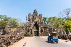 Tuk tuk and angkor thom gate in siem reap cambodia Royalty Free Stock Photos