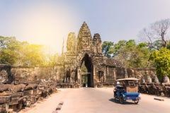 Tuk tuk and angkor thom gate in siem reap cambodia Royalty Free Stock Photo