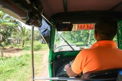 Tuk tuk driver in Sri Lanka stock image