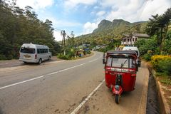 Tuk tuk parked next to road royalty free stock image