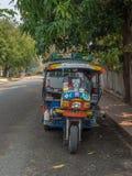 Tuk Tuk parked by side of road. Luang Phabang, Laos, Asia stock image