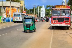 Tuk-Tuk rides on the shopping street of the village on a typical day Stock Image