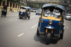 Tuk-tuk. (cab) speeding on the street. Picture taken in Bangkok / Thailand