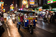 Tuk - tuk on Chinatown street at night Royalty Free Stock Images