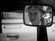 Tuk Tuk Driver. Chiang Mai, Thailand - February 25: Unidentified Tuk Tuk driver looks in the rear mirror to the photographer on February 25, 2015 in Chiang Mai Royalty Free Stock Images