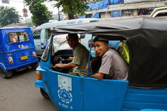 Tuk Tuk driver and passanger in Jakarta, Indonesia Royalty Free Stock Photography