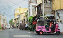 Tuk Tuk driver waiting for Customers at local narrow street.
