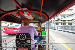 A tuk tuk negoting a back street in the busy town Royalty Free Stock Photo
