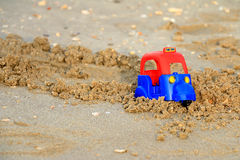 Tuk tuk, Plastic toy on the beach. Royalty Free Stock Photos
