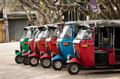 Tuk-tuk is a popular asian transport as a taxi. Tuk-tuk is the most popular transport type on Asian streets Stock Photos
