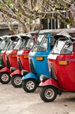 Tuk-tuk is a popular asian transport as a taxi. Tuk-tuk is the most popular transport type on Asian streets Royalty Free Stock Photography