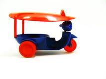 Tuk-tuk rojo y azul Imagen de archivo libre de regalías