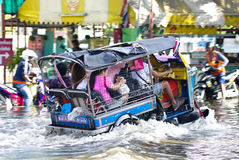 Tuk tuk run through flooded road Royalty Free Stock Photography