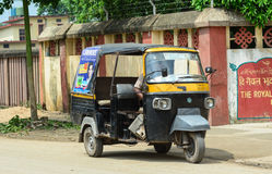 A tuk tuk running on street in Agra, India.  Stock Photos