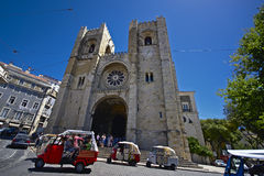 Tuk tuk's in front of lisbon cathedral Stock Photo