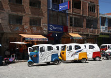 Tuk Tuk taxi cars in a raw in a street of Coroico, Bolivia Royalty Free Stock Photo