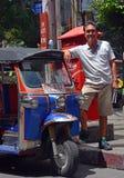 Tuk Tuk Taxi Driver in Bangkok, Thailand. Stock Photo