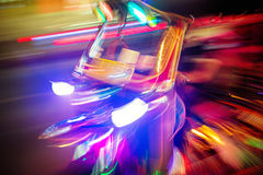 Tuk tuk taxi at night. Motion blurred art type photo Stock Photo