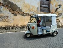 A tuk tuk taxi at old town. Galle, Sri Lanka - Sep 9, 2015. A tuk tuk taxi at old town in Galle, Sri Lanka. Galle was the main port on the island in the 16th Royalty Free Stock Image