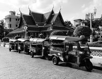 Tuk tuk taxi in thailand. Tuk tuk taxi parked in front of thai pavilion stock image