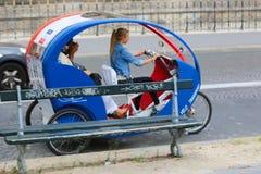 Tuk tuk taxi transports  in Paris Royalty Free Stock Image