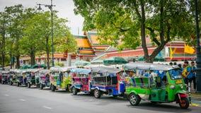 Tuk Tuk taxi waiting customers on street at Wat Phra Chetupon Vimolmangklararm (Wat Pho) temple. Stock Images