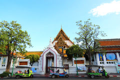 Tuk Tuk taxi waiting customers about Temple Bangkok, Thailand Royalty Free Stock Photos