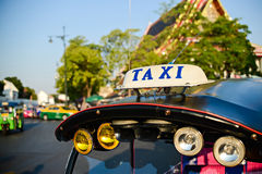 Tuk-tuk taxis in Bangkok. Shallow depth of field with the neares stock photography