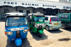 Tuk tuk taxis parked in front of Colombo Fort train station stock image