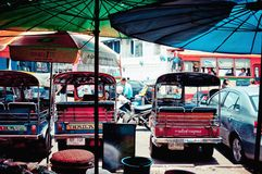 Tuk tuk taxis on the road in Bangkok Stock Photos