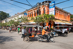Tuk-tuk tourist taxi on the central street of the old Siem Reap Royalty Free Stock Photos