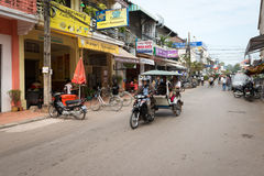 Tuk-tuk tourist taxi on the central street of the Siem Reap Stock Image