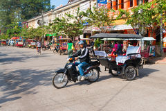 Tuk tuk with a trailer in a cambodian street. Royalty Free Stock Photos