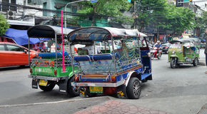 Tuk Tuk Tricycle in busy Bangkok downtown Stock Photo