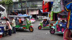 Tuk Tuk Tricycle in busy market in  Bangkok downtown Royalty Free Stock Image