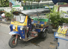 Tuk Tuk waiting for customers near Buddhist Temple Stock Image