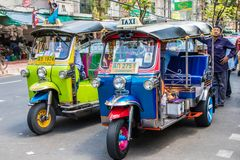 Tuk tuks and their drivers. Bangkok, Thailand - 26th Sept 2018: Tuk tuks and their drivers wait for business outside the flower market. The vehicles are mainly royalty free stock photography