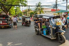 Tuk-tuks transport tourists around Chiang Mai, Thailand. CHIANG MAI, THAILAND - 6/13/2015: Tourists ride tuk-tuks around the city Stock Images