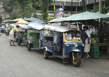 Tuk Tuks waiting for customers near Buddhist Temple Stock Photo