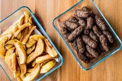 Tukish Meatballs Kuru Kofte with homemade potato wedges Stock Photos