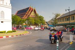 Traffic in front of temple Stock Photos
