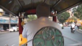 Tuktuk in Bangkok. Tuk tuk taxi driving in Bangkok stock video footage