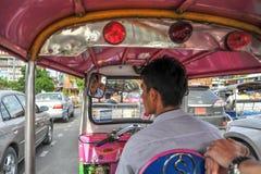 Tuktuk driver in Bangkok stock images
