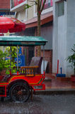 Tuktuk motocycle during rain monsoon in Kampot. Tuktuk during rain monsoon in Kampot Cambodia Royalty Free Stock Photo