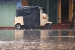 Tuktuk in rain. A tuktuk standing in the rain in Sri Lanka Stock Photo