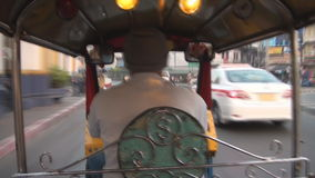 Tuktuk ride. Tuk tuk taxi driving in Bangkok stock footage