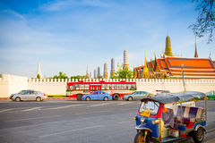 Tuktuk thailand taxi parking at the street with back ground Emerald Buddha temple(Wat phra kaew). Stock Images