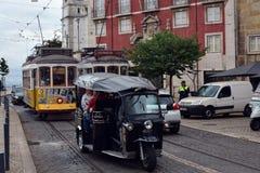 TukTuk and Yellow tram in Alfama. Lisboa. Portugal