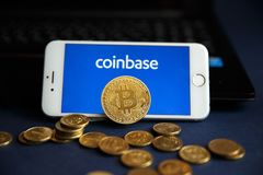 Tula, Russia - August 28, 2018 Bitcoin BTC on stack of cryptocurrencies with Coinbase logo in background. The royalty free stock photos