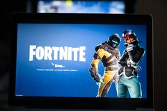 Tula, Russia - JANUARY 27, 2019 - Fortnite video game screen with character and console controller. Fortnight Battle. Royale online gaming by Epic Games stock photo